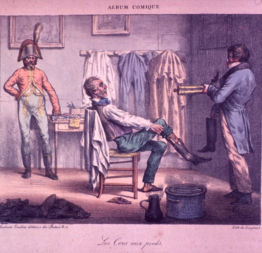 <p>A man, sitting in a chair, is putting on a boot with a shoe horn.</p>