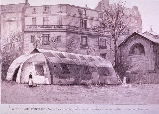 <p>Exterior view of supplemental tent hospital; large hospital building in the background.</p>