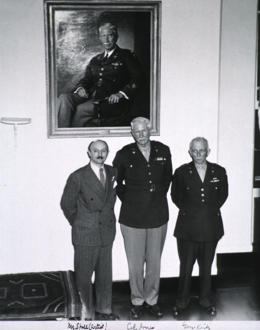 <p>Showing Jones and two others standing beneath portrait; all full length, full face.</p>