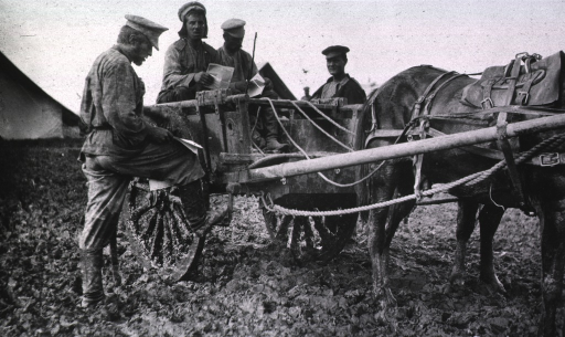 <p>Soldiers(?) with a horse drawn cart in the mud at Evacuation Commission Hospital.</p>
