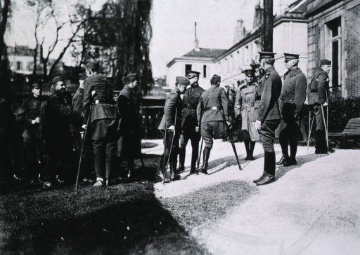<p>Capt. Reynolds shaking hands with fellow officers.</p>