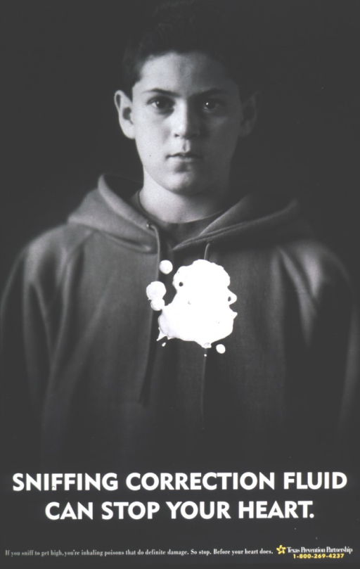 <p>Correction fluid stains the heart area of an adolescent boy's sweatshirt.</p>