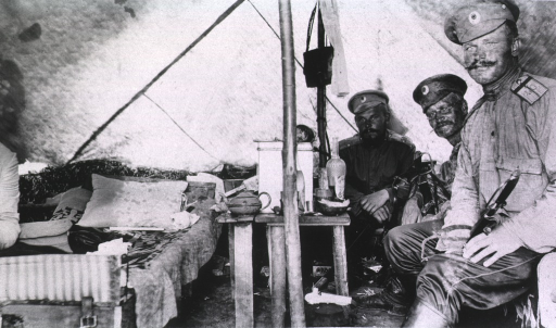 <p>A view of three officers in their tent.</p>