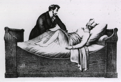 <p>A woman is lying on a bed during an obstetrical examination.</p>