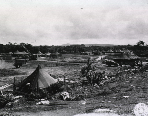 <p>View of a group of tents pitched on a field.</p>