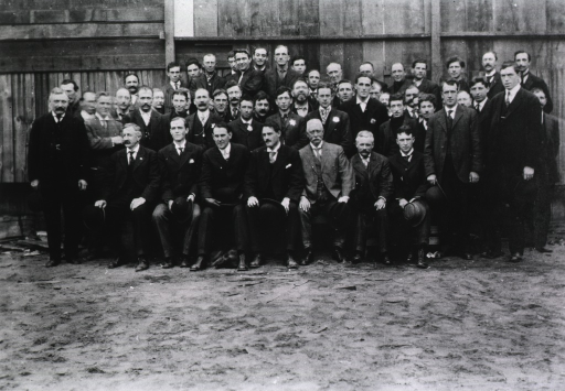 <p>Group portrait of unidentified men, possibly public health service workers, during the San Francisco plague campaign; some of the men are wearing badges (second row, center).</p>