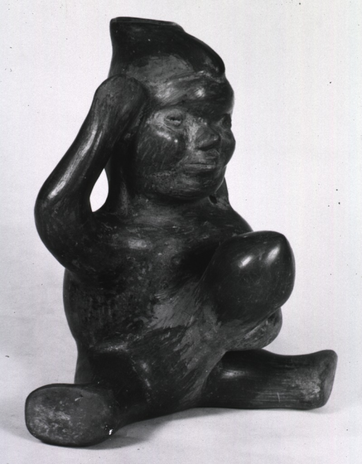 <p>Sculpture:  Spouted urn of seated male with enlarged penis.</p>