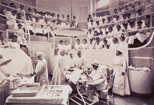 <p>Interior view of the clinical amphitheater with an operation in progress.</p>