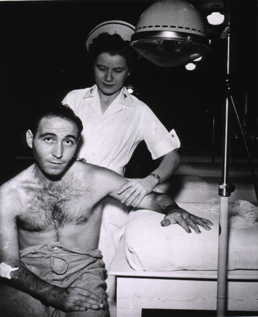 <p>Soldier receiving heat massage, muscle re-education &amp; exercise for wounded hand.</p>