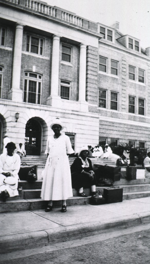 <p>Showing African American students in front of a building.</p>