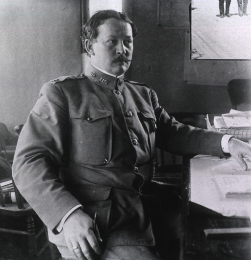 <p>Dr. Rupert Blue dressed in the uniform of the United States Public Health and Marine Hospital Service, at his desk, during the San Francisco plague campgain.</p>