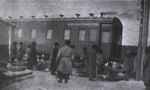<p>Soldiers(?) load a hospital railroad train during the winter months.</p>