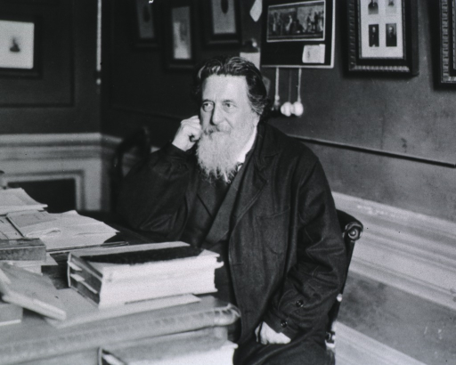 <p>Seated, left pose, at desk in his study.</p>