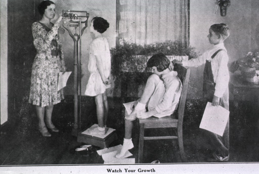 <p>Showing children being weighed and measured.</p>