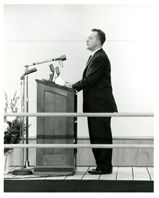 <p>Dr. Frank B. Rogers, National Library of Medicine Director, addresses the audience at the NLM Dedication Ceremony.</p>