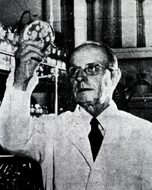 <p>Head and shoulders, full face, holding petri dish in right hand.</p>