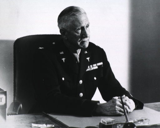 <p>Half-length, seated at desk, right pose; wearing uniform.</p>