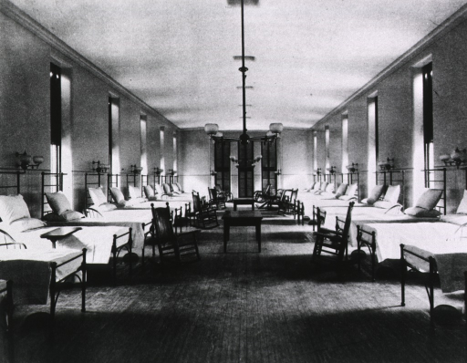 <p>Interior view of a ward at Johns Hopkins Hospital with ventilating screens in floor.</p>