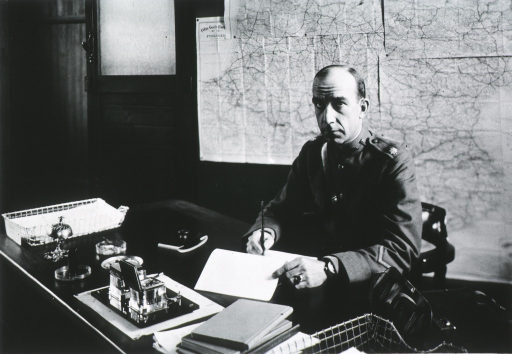 <p>Seated at desk, full face, wearing uniform (Lieut. Colonel).</p>