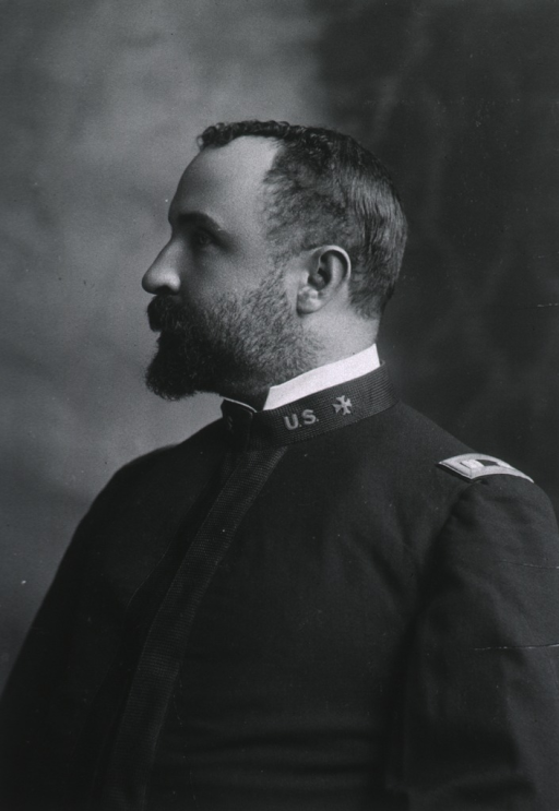 <p>Head and shoulders, left profile, wearing uniform.</p>