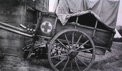 <p>A view of an ambulance cart that carries two litters beside a building.</p>