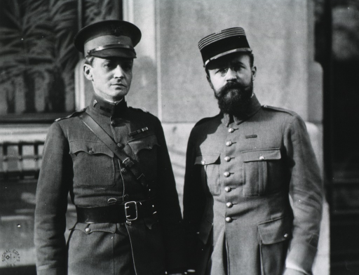 <p>Both half-length, standing, full face; wearing uniforms and caps.</p>