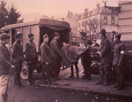 <p>Several soldiers are assisting in the unloading of patients from ambulances.</p>