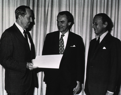 <p>The Nobel Laureate, Sune Bergstrom, of the Karolinska Instituet, Stockholm, is standing between Drs. Robert S. Stone, director of the National Institutes of Health, and Donald S. Fredrickson, director of intramural research.  Dr. Stone is holding a white folder.</p>