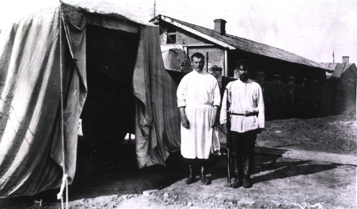 <p>A niew of a surgeon(?) and a guard standing beside a guard's tent.</p>