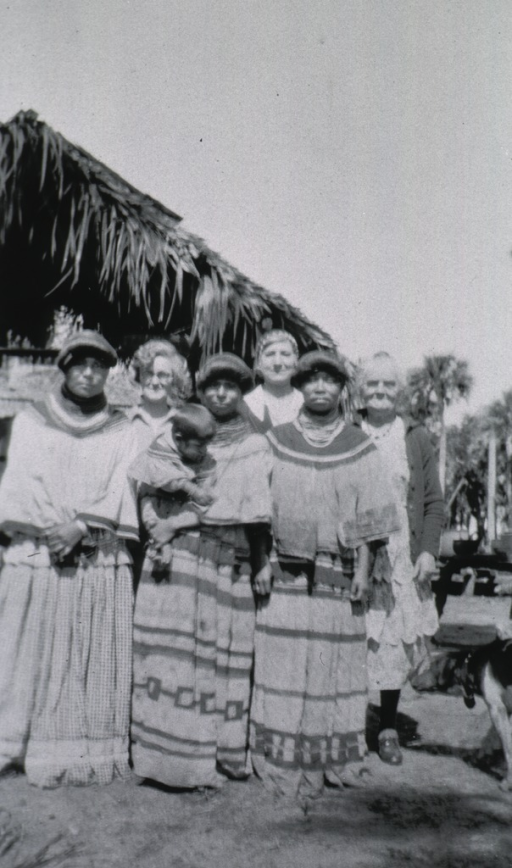 <p>View of Seminole Indians, one holding a child.</p>
