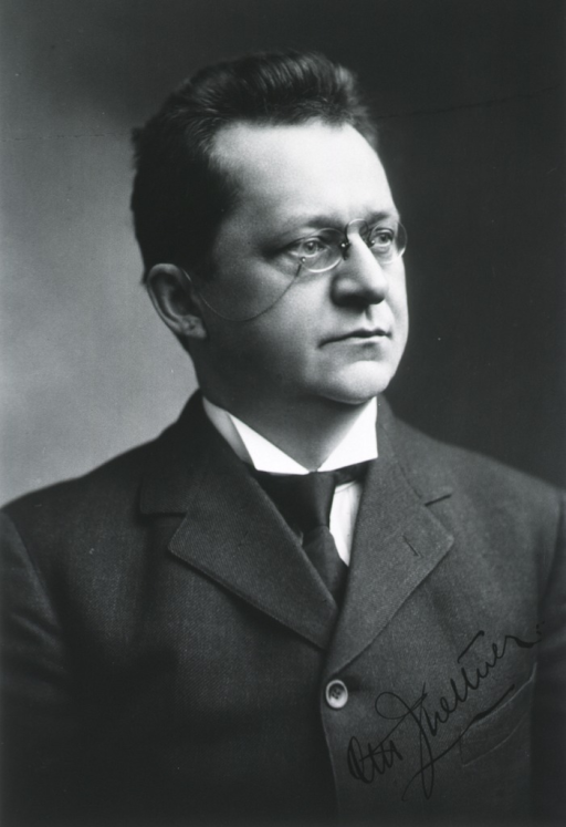 <p>Head and shoulders, front pose, head turned to the right; wearing glasses.</p>