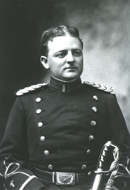 <p>Head and shoulders, front.  In uniform, showing top of sword.</p>
