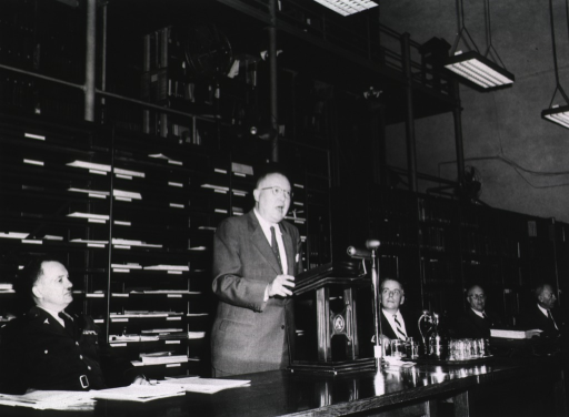 <p>Interior view:  Four of the six-person panel are in Library Hall at the Acquisition Policy of the National Library of Medicine Symposium held April 12, 1956.  Dr. Frank Rogers is sitting to the left of the speaker.</p>