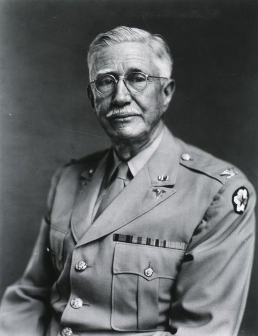 <p>Half-length, left pose, full face; wearing glasses and uniform.</p>