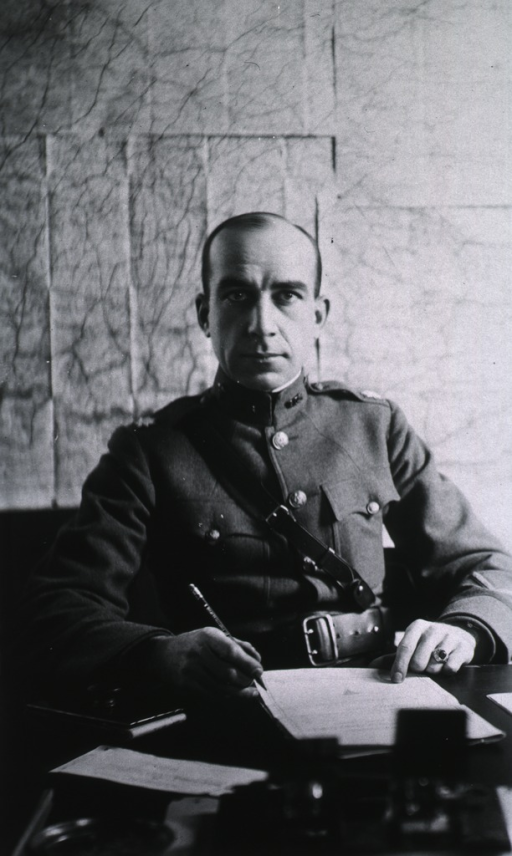 <p>Seated at desk, wearing uniform (Lieut. Colonel).</p>