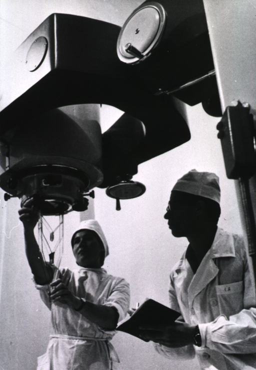 <p>Technical specialists prepare a gamma-radiation machine for use.</p>