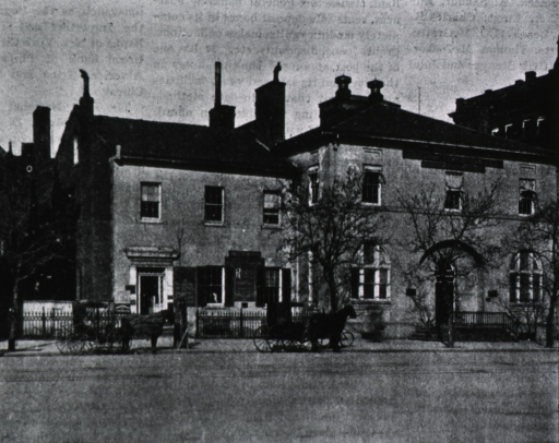 <p>Front view of the Rigg's building.  A typed caption is above the image.</p>
