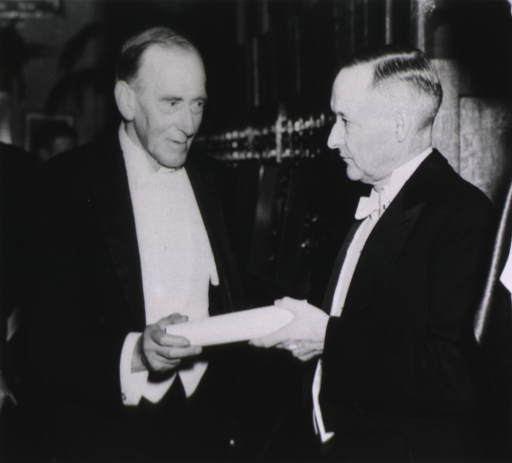 <p>Interior view: At the 100th anniversary celebration in Washington, D.C. in 1936 Sir Humphry Rolleston, on the left, is receiving a diploma from General Charles Reynolds.</p>