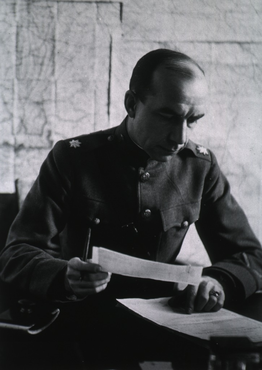 <p>Seated at desk, turned slightly to right, wearing uniform (Lieut. Colonel).</p>