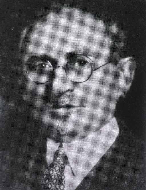 <p>Head and shoulders, wearing glasses.</p>
