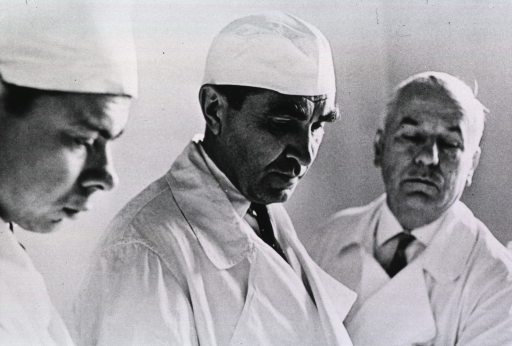 <p>Head and shoulders of Blokhin and two men; all wearing white coats.</p>