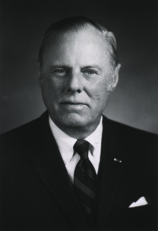 <p>Head and shoulders, full face, wearing dark suit and tie.</p>