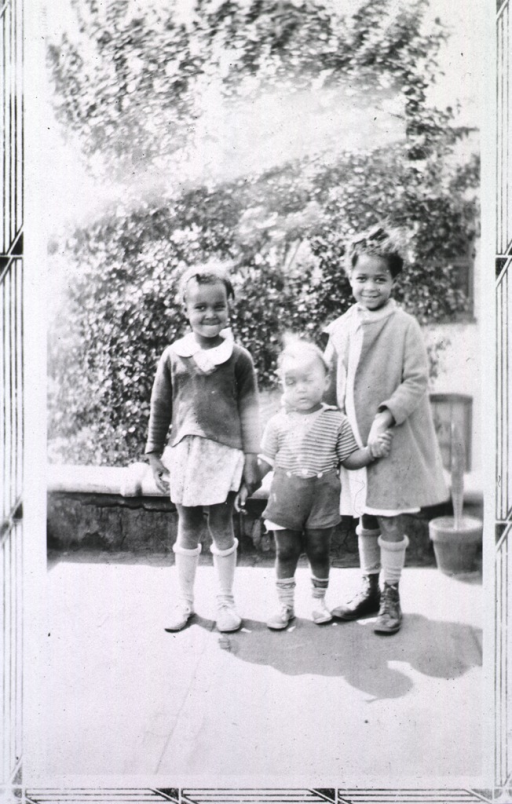 <p>Showing two little girls and their baby brother(?).</p>