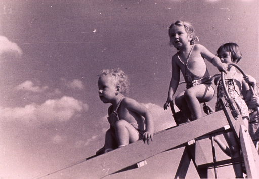 <p>Children are playing on a slide.</p>