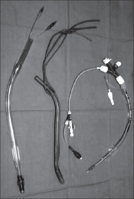 Lung separators. (from L to R) Double lumen tube (right sided - note slot for upper lobe bronchus): Endobronchial tube (Macintosh Leatherdale - left sided): Bronchus blocker (Cohen/Cook model) and ancillary