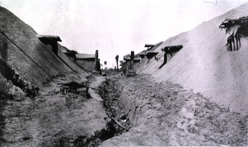 <p>A view of a dugout running between two rows of sod houses.</p>