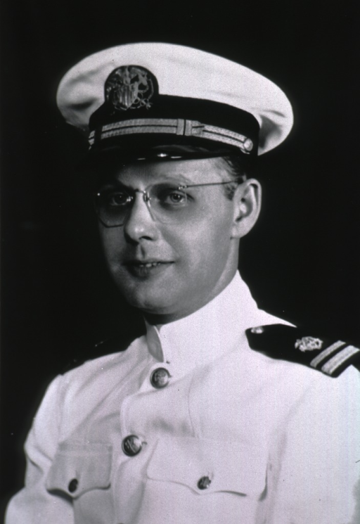 <p>Head and shoulders, full face, body to left, wearing USPHS white uniform with shoulder epaulets and cap.</p>