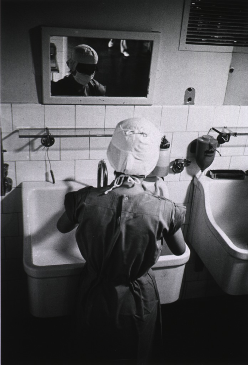 <p>Dr. Brazauskas scrubs up before an operation.</p>
