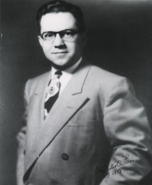 <p>Three quarter-length, left pose, full face; wearing glasses.</p>