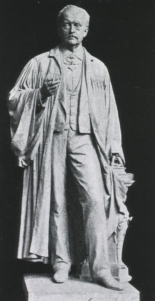 <p>Statue, full length, full face, wearing robe over clothing.</p>